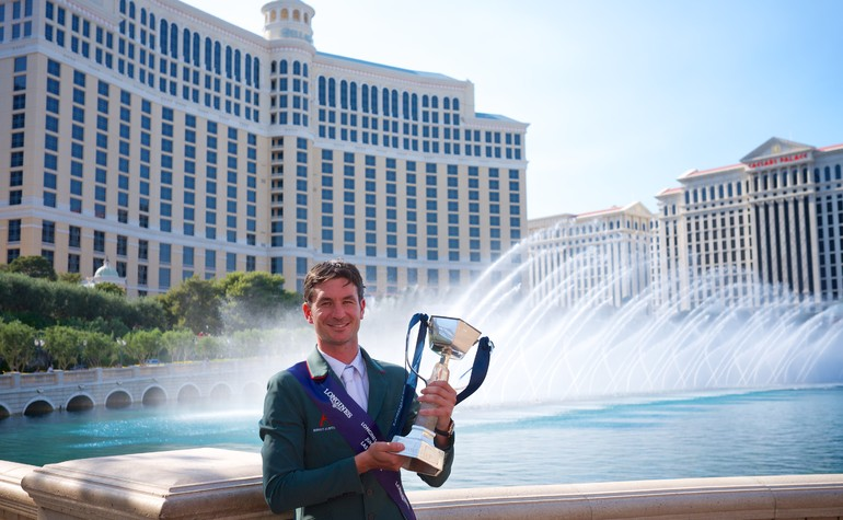 Switzerland's Olymoic champion Steve Guerdat raises the trophy aloft after victory in the Longines FEI World Cup™ Jumping Final in Las Vegas (USA). Equestrian - Longines FEI World Cup™ Jumping Final in Las Vegas (USA) Equestrian - Longines FEI World Cup™ Jumping Final in Las Vegas (USA) date 15/04/2015 - 19/04/2015 Credit: FEI/Arnd Bronkhorst/Pool Pic Disclaimer: Free of charge for editorial use. For further information, contact Ruth Grundy +41 78 750 61 45, ruth.grundy@fei.org